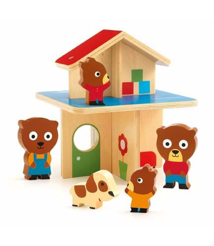 Drewniany domek z rodziną misiów