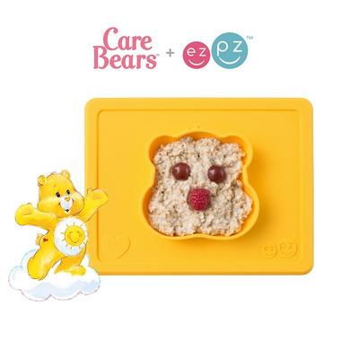 EZPZ, Silikonowa miseczka z podkładką 2w1 Care Bears™ Bowl Misia Słoneczne Serce Funshine Bear żółta